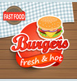 Burgers Label on the wood background vector image vector image