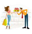 man handing woman a gift vector image