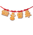 gingerbread cookies set on garland isolated vector image vector image