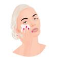 a girl covering a cream onto her face vector image
