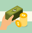 hand holding banklnote and pile coins money vector image vector image