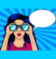 woman looks through binocular pop art vector image