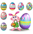 A bunny painting the eggs vector image vector image