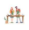 couple man and woman cooks pizza together at table vector image