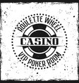 casino round badge or emblem on grunge background vector image vector image