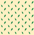 seamless leaf pattern on yellow background green vector image