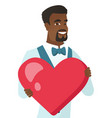 young african-american groom holding a big heart vector image vector image