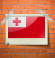 Flags Tonga scotch taped to a red brick wall vector image vector image