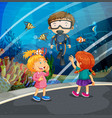 girls looking at fish and diver in the aquarium vector image vector image