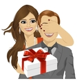 woman standing behind man with gift vector image