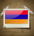 Flags Armenia at frame on wooden texture vector image