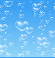 heart shaped bubbles in water on blue background vector image