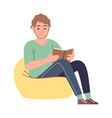 reader man reading literature sitting on yellow vector image