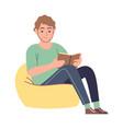 Reader man reading literature sitting on yellow