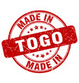 made in togo red grunge round stamp vector image vector image