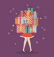 Santa woman holding a pile of gift boxes vector image vector image