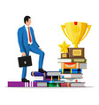 businessman with trophy on stack books vector image vector image