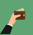 payment concept hand holding wallet with dollars vector image vector image