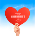 Holiday valentine background with hand holding red vector image vector image