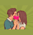 young couple kissing hollding pink heart man and vector image