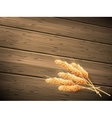 Wheat on wooden background EPS 10 vector image vector image