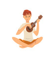 young man sitting on floor and playing ukulele vector image