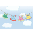 Four hanging dresses vector image vector image