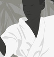 The boy is engaged in karate on a light background vector image vector image