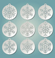 paper christmas balls with puched snow flakes vector image vector image