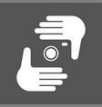 nands and camera logotype human hands making a vector image