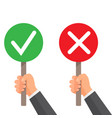 man hand hold signboard green check mark and red x vector image