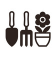 gardening tools and flower pot icon vector image vector image
