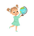 cute girl holding globe studying geography