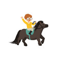 cheerful redhead little boy riding pony horse vector image