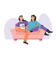 two happy women sitting on couch and spending time vector image vector image