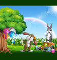 easter bunnies and colorful egg on the garden vector image vector image