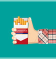 open pack of cigarettes in hand man vector image