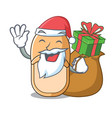santa with gift casual home slippers on mascot vector image