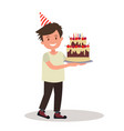 children s birthday boy holding a large cake vector image vector image
