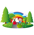 two boys playing with ball in park vector image vector image