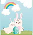 happy easter white bunnies with green egg in the vector image