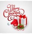 Christmas gift box and Santa hat vector image vector image