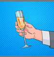 male hand holding glass champagne wine pop art vector image vector image