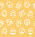 endless pattern decorated eggs on amber backdrop vector image vector image