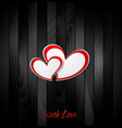 Valentine hearts on black wooden texture vector image