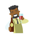 african waiter holding glass and bottle of wine vector image vector image