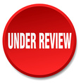 under review red round flat isolated push button vector image vector image