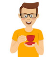 young man with glasses holding cup of tea vector image
