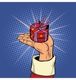 Hand of Santa Claus with round gift box vector image vector image