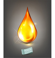 golden drop of oil on a gray background vector image